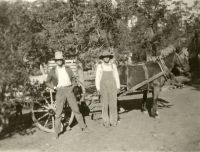 vintage theme unknown cowboys with wagon