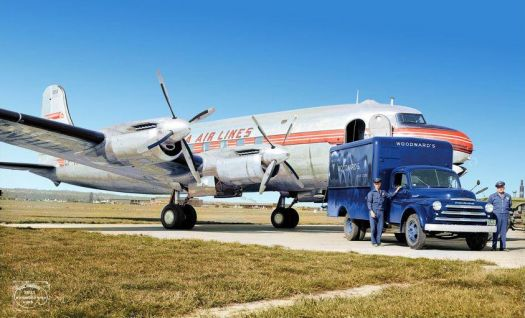 1948 - Trans Canada airlines DC-4 with a Fargo Woodward's delivery truck in Vancouver BC