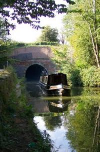 Narrowboat leaving Braunston Tunnel East end
