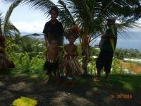 Family waiting at roadside in Alatau New Guinea