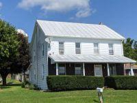 New roof coating on older farmhouse