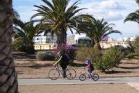 Spain. A Grandpa taking a cycle ride with his granddaughter