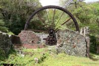 Giant waterwheel of an old sugar-cane mill.