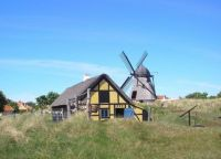 Windmill and old house in Skagen