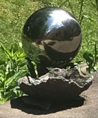 Gazing ball and water bowl for birds.