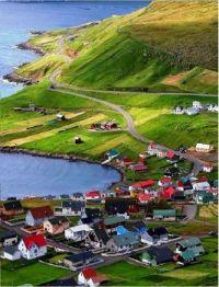 Gásadalur (Danish: Gåsedal) is a village located on the west side of Vágar, Faroe Islands