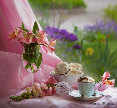 mikasa cup of coffee with pink freesia lupine flowers