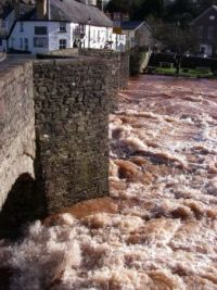 Crickhowell Bridge and river in flood