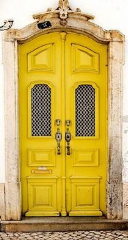 Yellow Doors With Heavy Knockers
