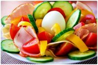 Delicious Salad with Veggies, Sliced Ham, and a Hard Boiled Egg