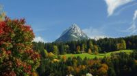 Snow-Capped Mountain Peak In Autumn
