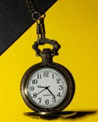Timepiece on yellow