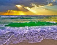 Awesome nature - Golden rays on Emerald waves