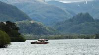 A pleasure boat against the backdrop Derwentwater