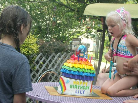 Lily's 5th - blowing out the candles
