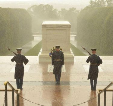 Watching over the tomb of the unknown soldier during hurricane. I salute you!