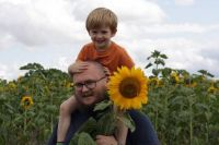 Piggly and Daddy picking sunflowers
