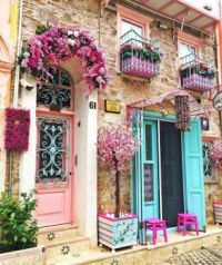 Doors in pink and turquoise with flower balconies