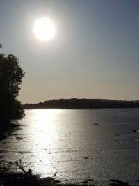 Sun over river Plym