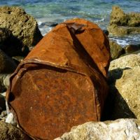 Rusty Drum on the Rocks
