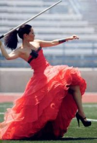 This is Lucy Liu throwing a javelin in a dress and high heels