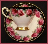 Pinknblack teacup and saucer