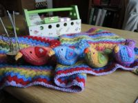 crochet blanket and birds