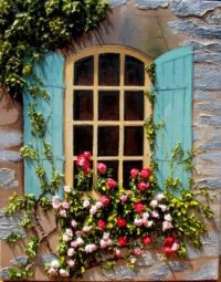 Turqoise shutters with flowering vine