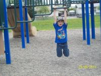 Dominic playing on his old school playground.