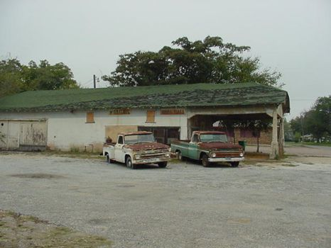 Old service station and 2 trucks