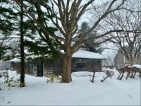 House and Barn in the Snow