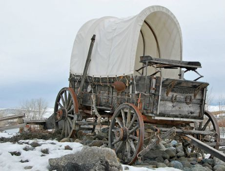 covered_wagon deserted in the winter
