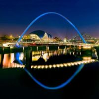 Night view of Gateshead Millennium Bridge in New Castle England