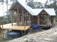 Strawbale house frame with deck.