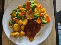 Beef in gravy ready meal with potatoes and extra vegetables