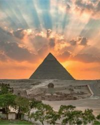 The sunset over the Giza Pyramids, as seen from Cairo.