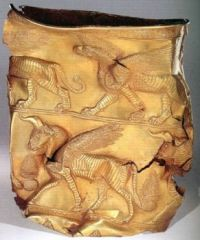 Golden Cup depicting Griffin on top band