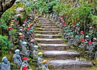 Small Rakin Statues line the Stone Pathway  to the Daisho-in Temple, Miyajima, Japan