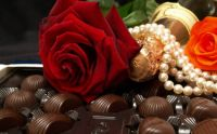 womans best friends, roses, pearls and chocolats.
