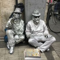 Two Silver Men Begging
