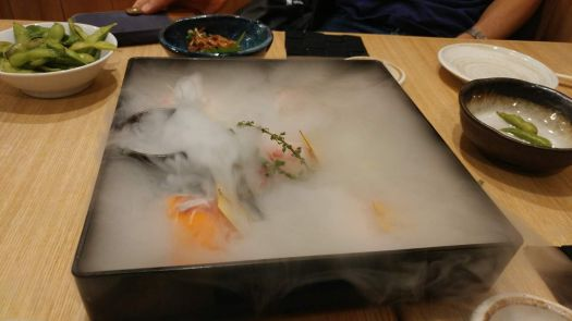 Sushi hidden by dry ice