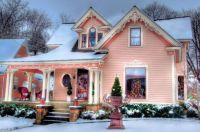 Pink Victorian home in winter