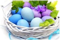 Pretty Pastel Easter Eggs in a White Wicker Basket
