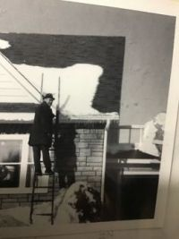 Vintage photo. My dad putting up Xmas lights