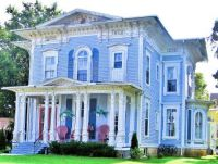 Large blue and white Victorian home