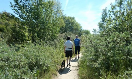 My daughter, her husband and dog Bobbie, with me on a trail through the dunes in Rockanje
