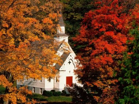 Country church nestled in autumn's spendor.