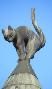 """Detail of one of the two bronze cats on the roof of """"The Cat House"""", Riga, Latvia"""