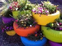 GARDEN IDEAS-USE OLD TIRES AS PLANTERS...