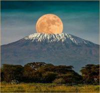 Mount Kilimanjaro giving birth to the Moon
